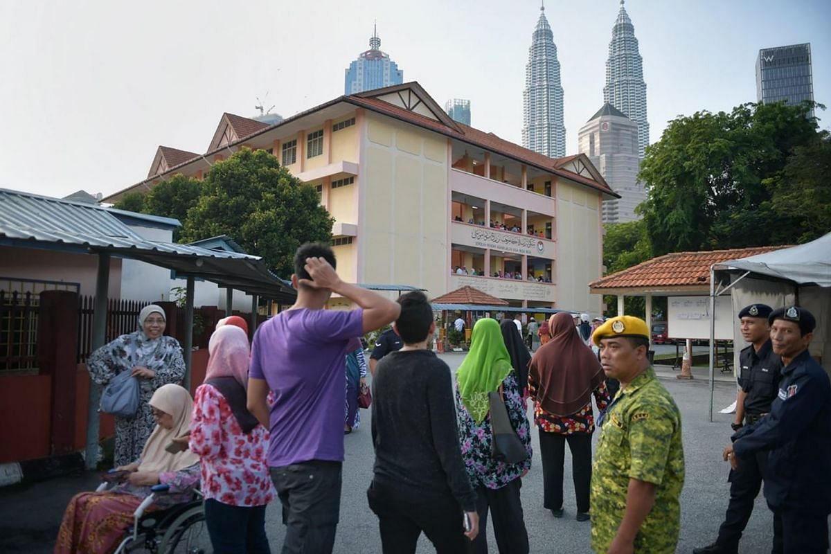 People queue to cast their votes at the Sekolah Rendah Agama Jalan Raja Muda Musa in Kampung Bahru, KL on May 9, 2018.