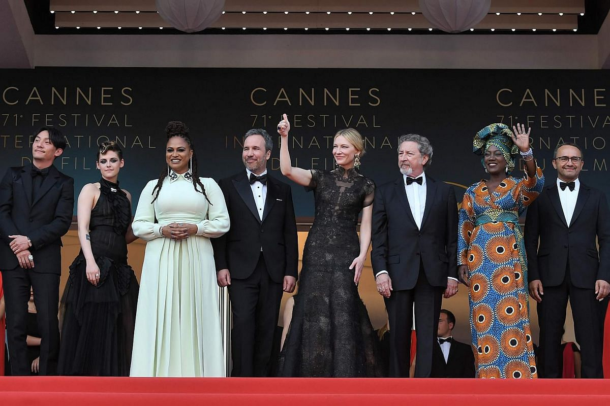 (Left to right) Member of the feature film jury Chang Chen, Kristen Stewart, Ava DuVernay, Denis Villeneuve, Cate Blanchett, Robert Guediguian, Khadja Nin, Andrey Zvyagintsev and Lea Seydoux pose on May 8, 2018, as they arrive for the screening of th