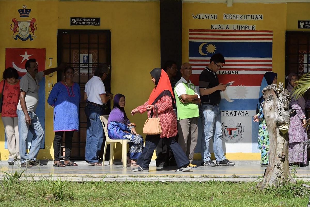Voters at SMK Pasir Gudang 3, Jalan Jati, Taman Air Biru, Pasir Gudang, Johor, Malaysia, on May 9, 2018.