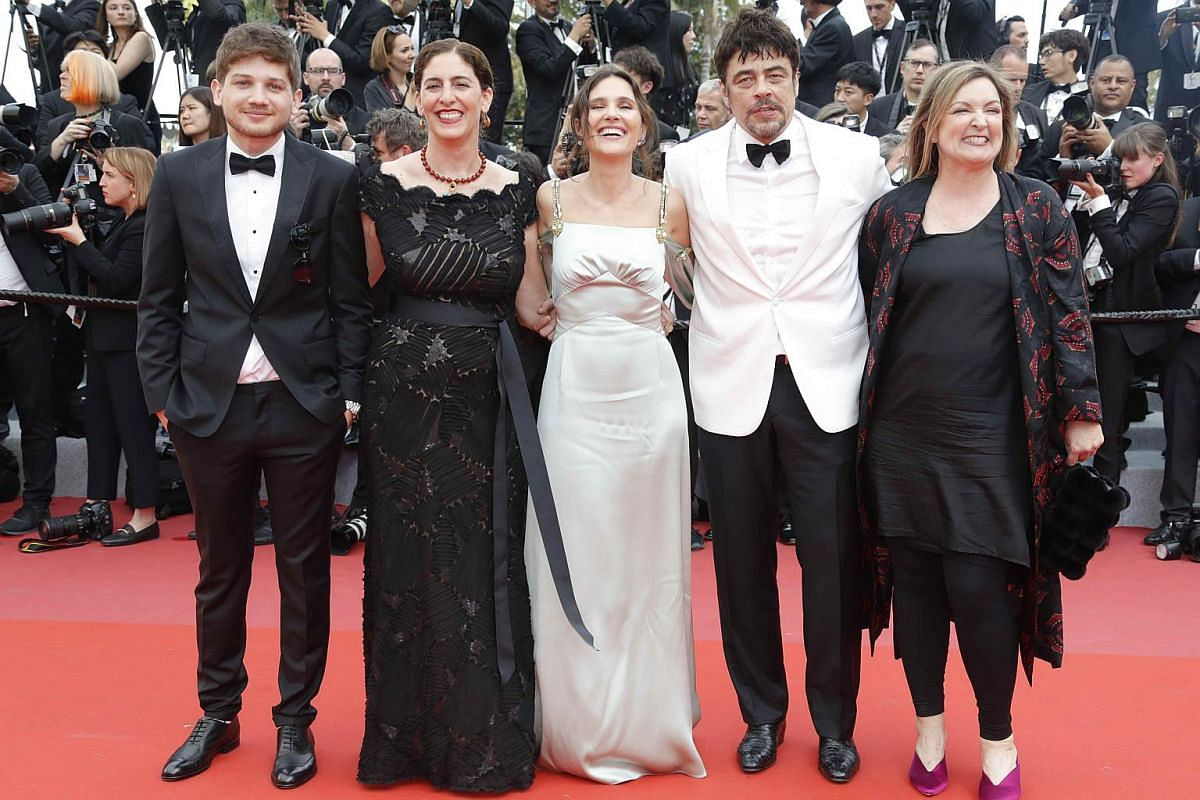 (From left) Kantemir Balagov, Annemarie Jacir, Virginie Ledoyen, Benicio Del Toro and Julie Huntsinger arrive for the screening of Everybody Knows (Todos Lo Saben) and the opening ceremony of the 71st annual Cannes Film Festival in Cannes, France, on