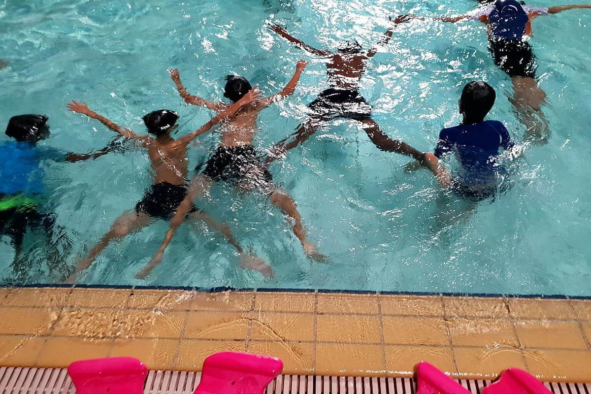 Six of the children from Chen Su lan Mehodist Children's Home compete to see who can hold their breaths underwater for the longest time.