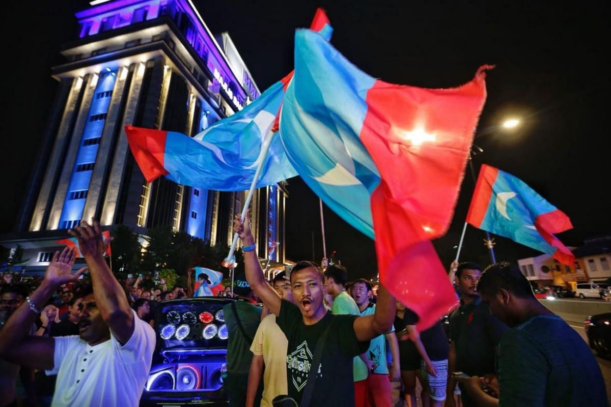 Supporters of Pakatan Harapan celebrating outside Majlis Bandaraya Iskandar Puteri on May 10, 2018.