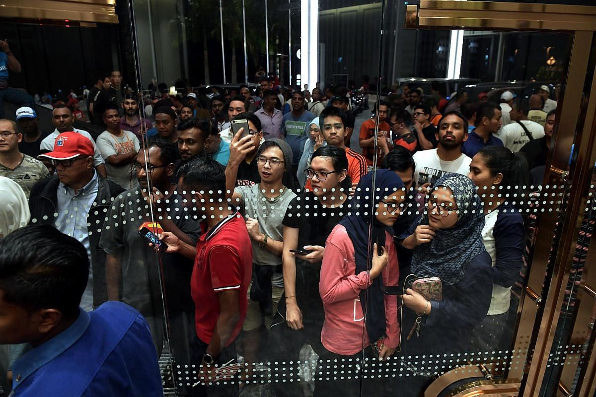 Supporters wait for Tun Mahathir Mohamad after he delivers his speech at the Sheraton Hotel in Petaling Jaya on Polling Day on May 9, 2018.
