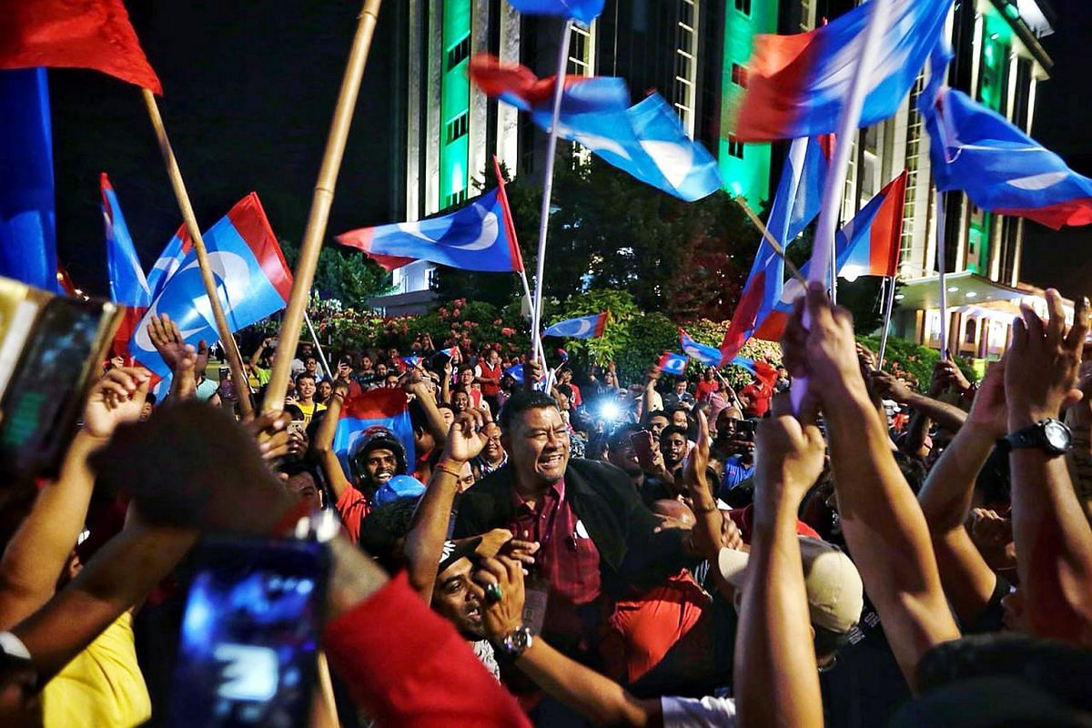 Kota Iskandar state seat Dr Dzulkefly of Pakatan Harapan celebrating and being carried by Pakatan Harapan supporters.