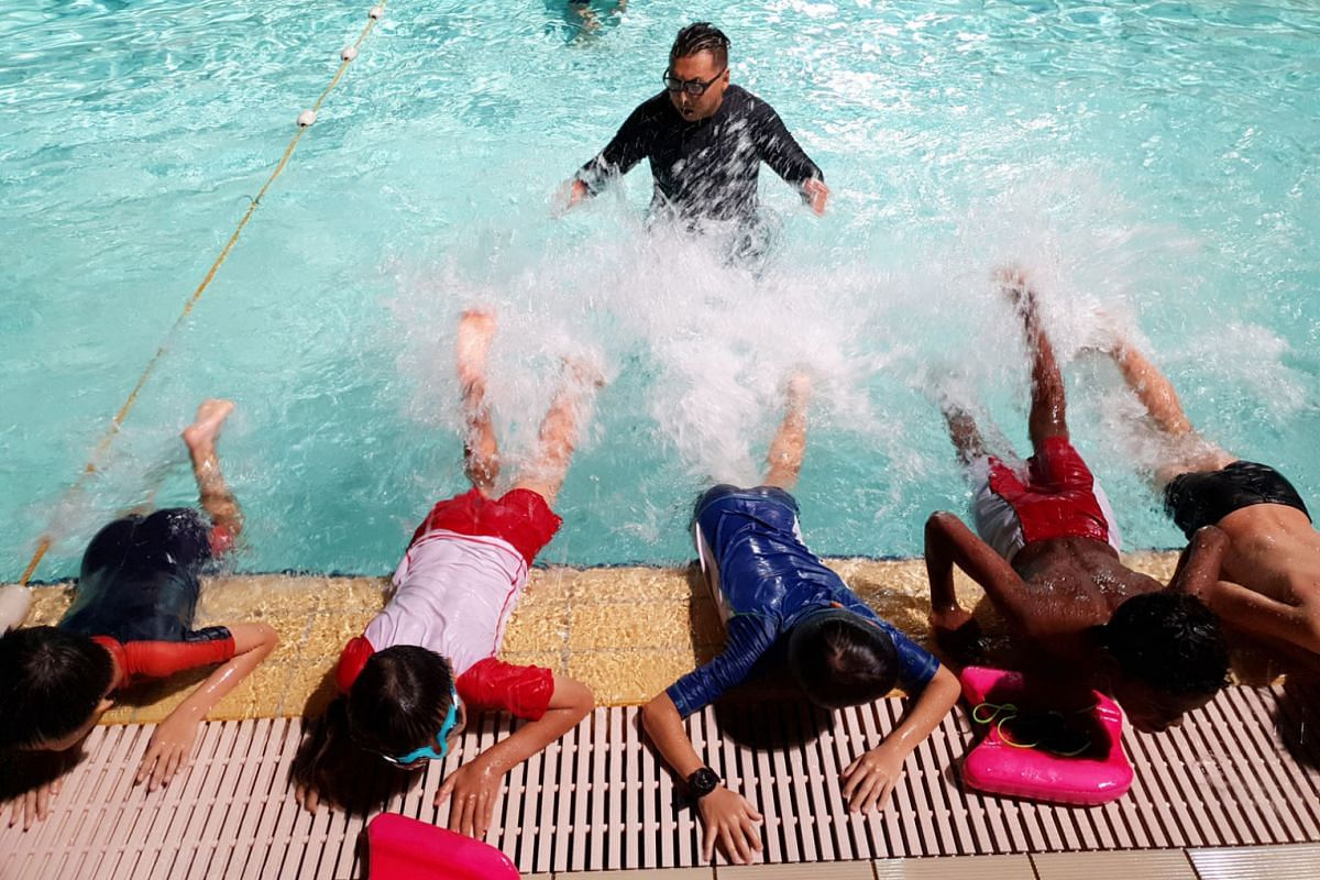 Five youngsters learning the breaststroke and freestyle from swim coach Mohd Faizal Bin Mohammed (centre), before progressing to the deeper end once they have gained enough confidence.