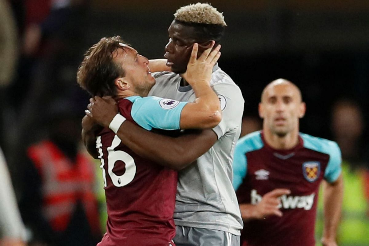West Ham United's Mark Noble clashes with Manchester United's Paul Pogba during the West Ham United v Manchester United Premier League soccer match in London Stadium, London, Britain on May 10, 2018 . PHOTO: REUTERS