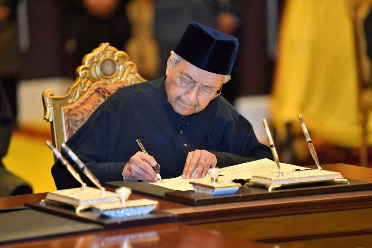 Tun Dr Mahathir Mohamad, 92, being sworn in as Malaysia's seventh prime minister.