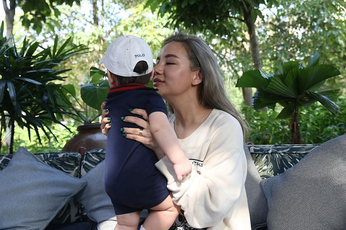 Kim Lim taking care of her son