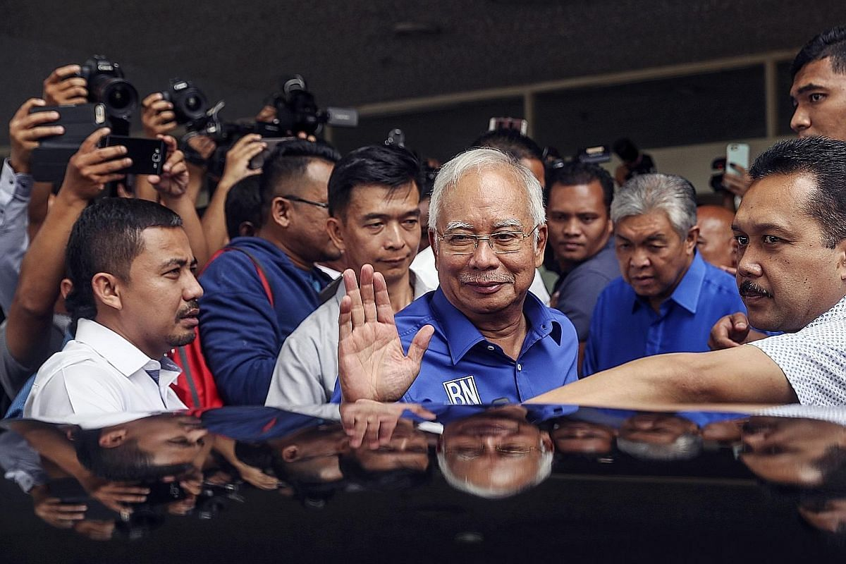 MAY 10: Mr Najib's first public appearance after the election, at the Barisan Nasional coalition headquarters. He said he accepted the people's verdict but added that no single party had won a simple majority and the King would determine who the next