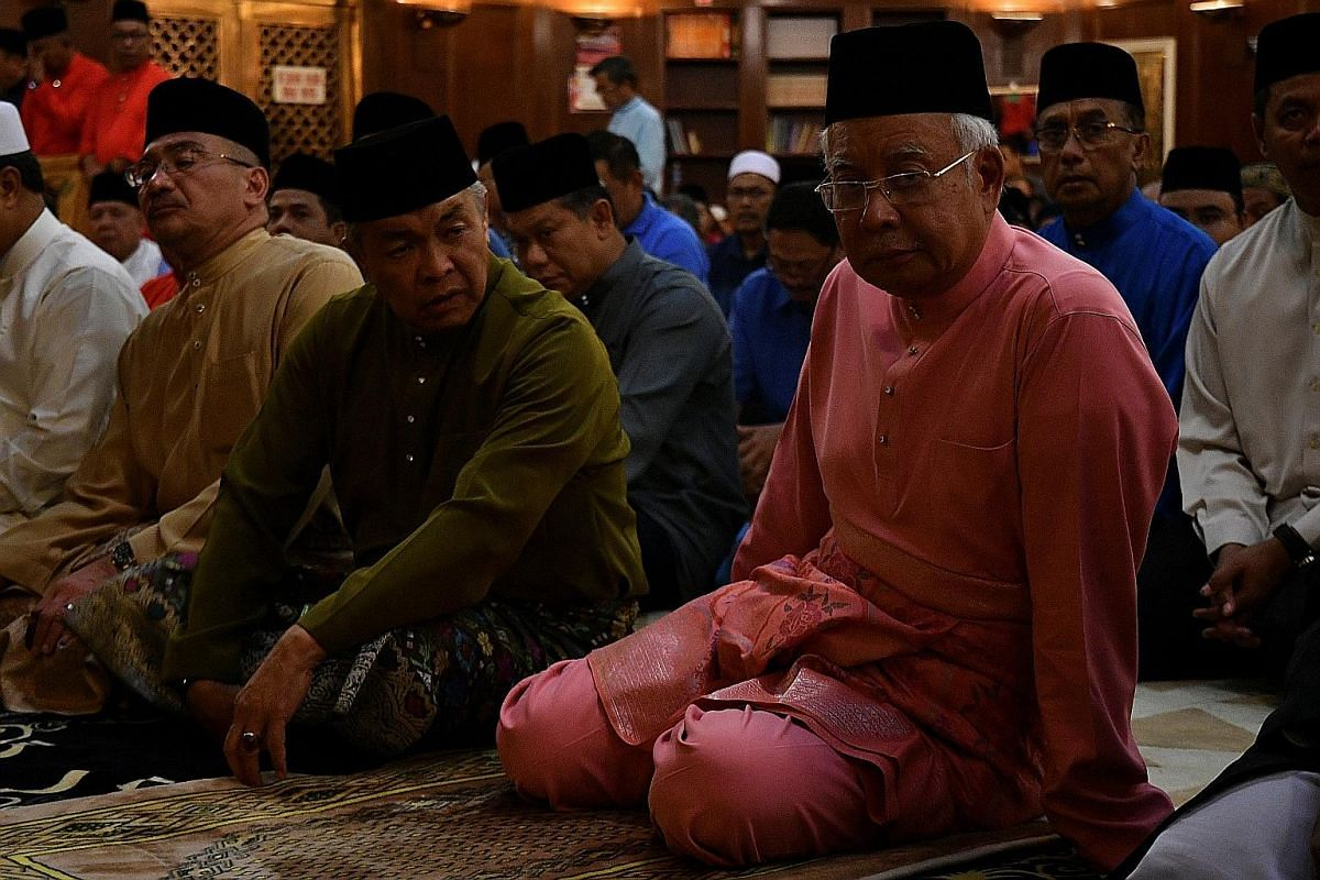 MAY 11: Mr Najib at the 72nd Umno anniversary event. The leaders had dinner after prayers. He did not take media questions. The event was supposed to have been a celebration of yet another election victory, but the mood was funereal.