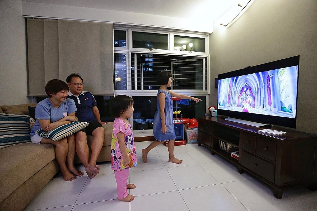 Stay-at-home mum Cecilia Eow, her husband Augustine Tai and their daughters, Lydia and Angeline, watching My Little Pony during a movie night at home. Mr Michael Buyung Santoso Raditya and his wife Pee Lean Choo prefer that their son Kairos watch car