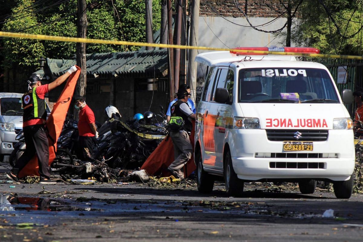 Indonesian police officers at the scene of a bomb blast in front of a church in Surabaya, East Java, Indonesia, 13 May 2018. PHOTO: EPA-EFE