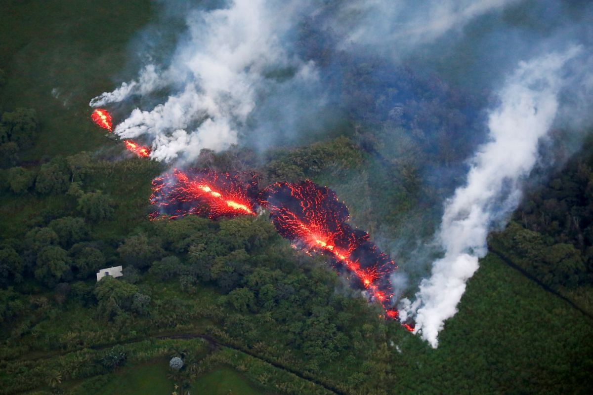 Lava erupts from a fissure east of the Leilani Estates subdivision during ongoing eruptions of the Kilauea Volcano in Hawaii, U.S., May 13, 2018. PHOTO: REUTERS