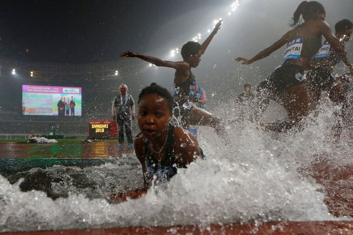 Bahrain's Winfred Mutile Yavi falls in a water jump during the women's 3000m steeplechase Diamond League athletic event at  Shanghai Stadium, Shanghai, China on May 12, 2018. PHOTO: REUTERS