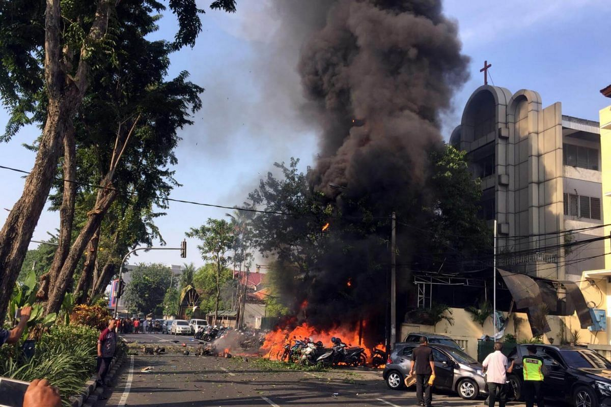 A burning vehicle seen shortly after a bomb blast at the church in Surabaya, East Java, on May 13, 2018.
