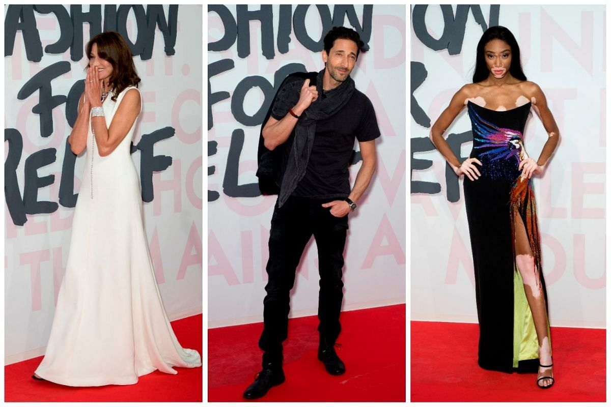Glamourous red carpet arrivals for the Fashion For Relief show, held at Hangar 16 Airport of Cannes Mandelieu, during the Cannes Film Festival. (From left) Carla Bruni, Adrien Brody and Winnie Harlow.