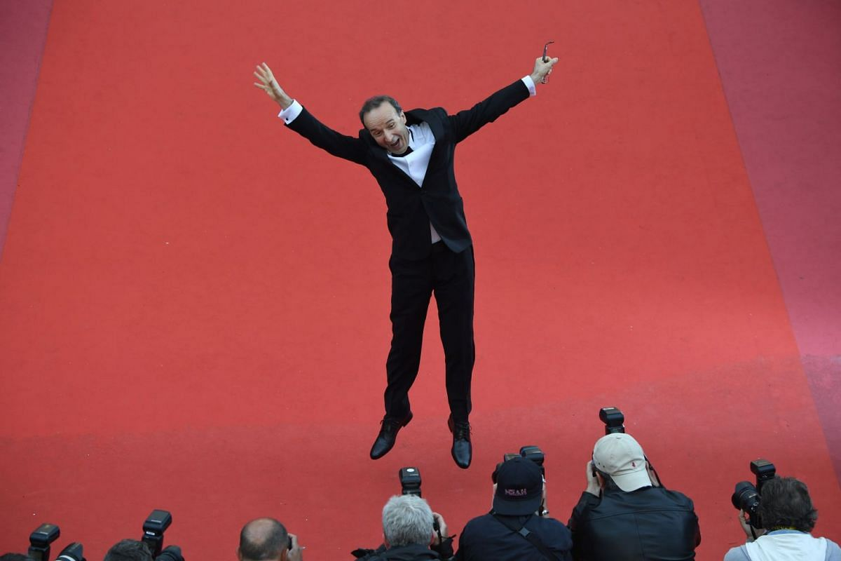 Italian actor and director Roberto Benigni poses on the red carpet for the screening of the film Happy As Lazzaro (Lazzaro Felice).