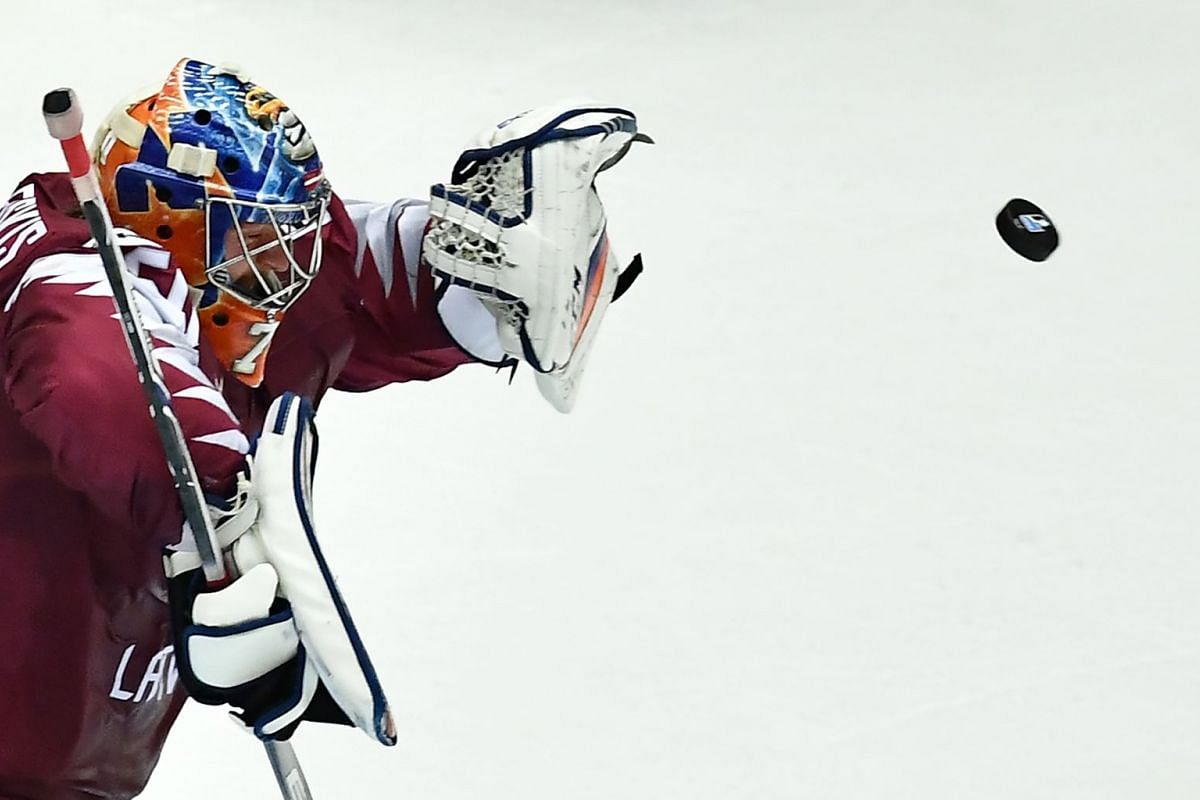 Latvia's Kristers Gudlevskis saves the puck during the group B match Canada vs Latvia of the 2018 IIHF Ice Hockey World Championship at the Jyske Bank Boxen in Herning, Denmark, on May 14, 2018. PHOTO: AFP