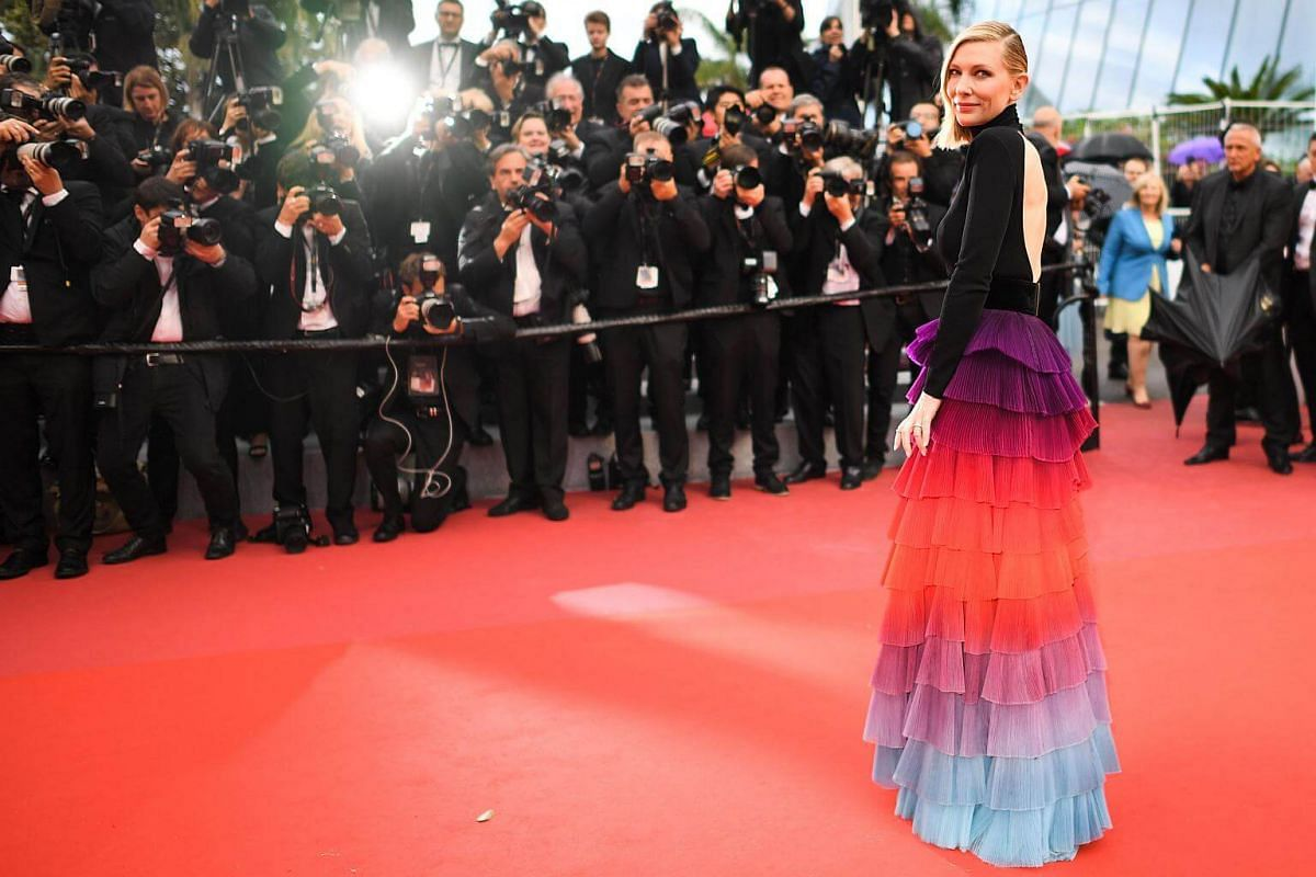 At the premiere of BlacKkKlansman on May 14, 2018, jury president Cate Blanchett lets this elegant tiered gown, with its multi-coloured ombre skirt, make its own statement by teaming it with a severe slicked-back hairstyle and understated makeup.