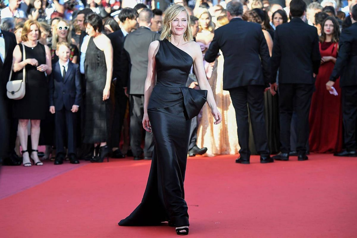 At the premiere of Girls Of The Sun (Les Filles du Soleil) on May 12, 2018, Blanchett is once again in a minimalist mode, shorn of jewellery other than elaborate drop earrings, but not short on grace in a sleek black gown set off by a dramatic bow de