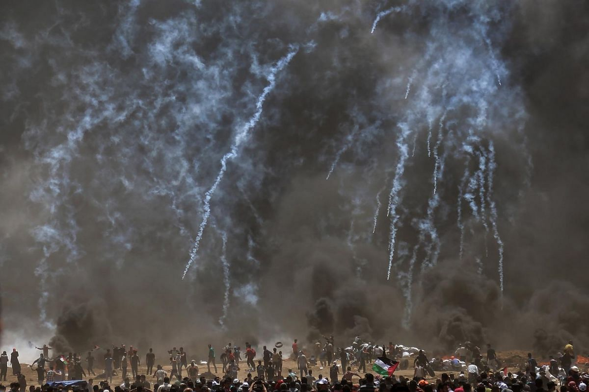 Israeli troops firing tear gas at Palestinian protesters during clashes after protests near the border with Israel on May 14, 2018.