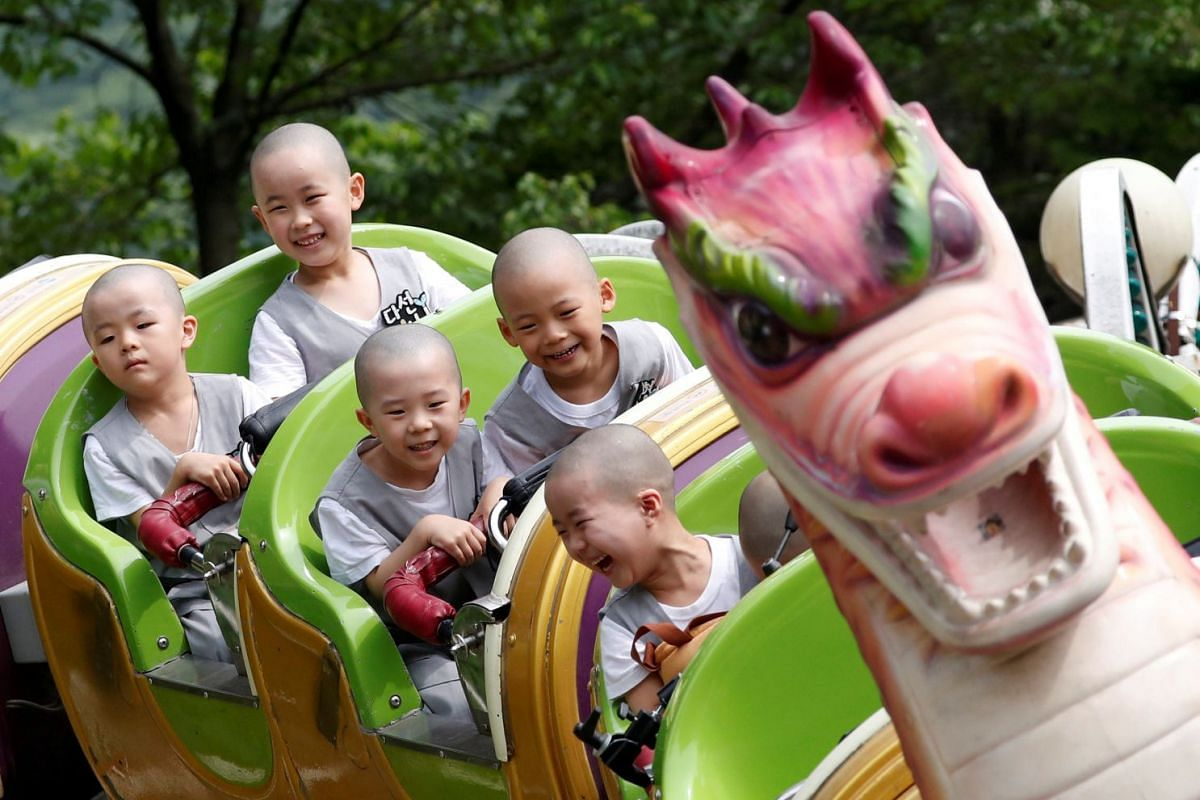 Boys, who are experiencing the lives of Buddhist monks by staying in a temple for two weeks as novice monks, enjoy a ride at the Everland amusement park in Yongin, South Korea, May 15, 2018. PHOTO: REUTERS