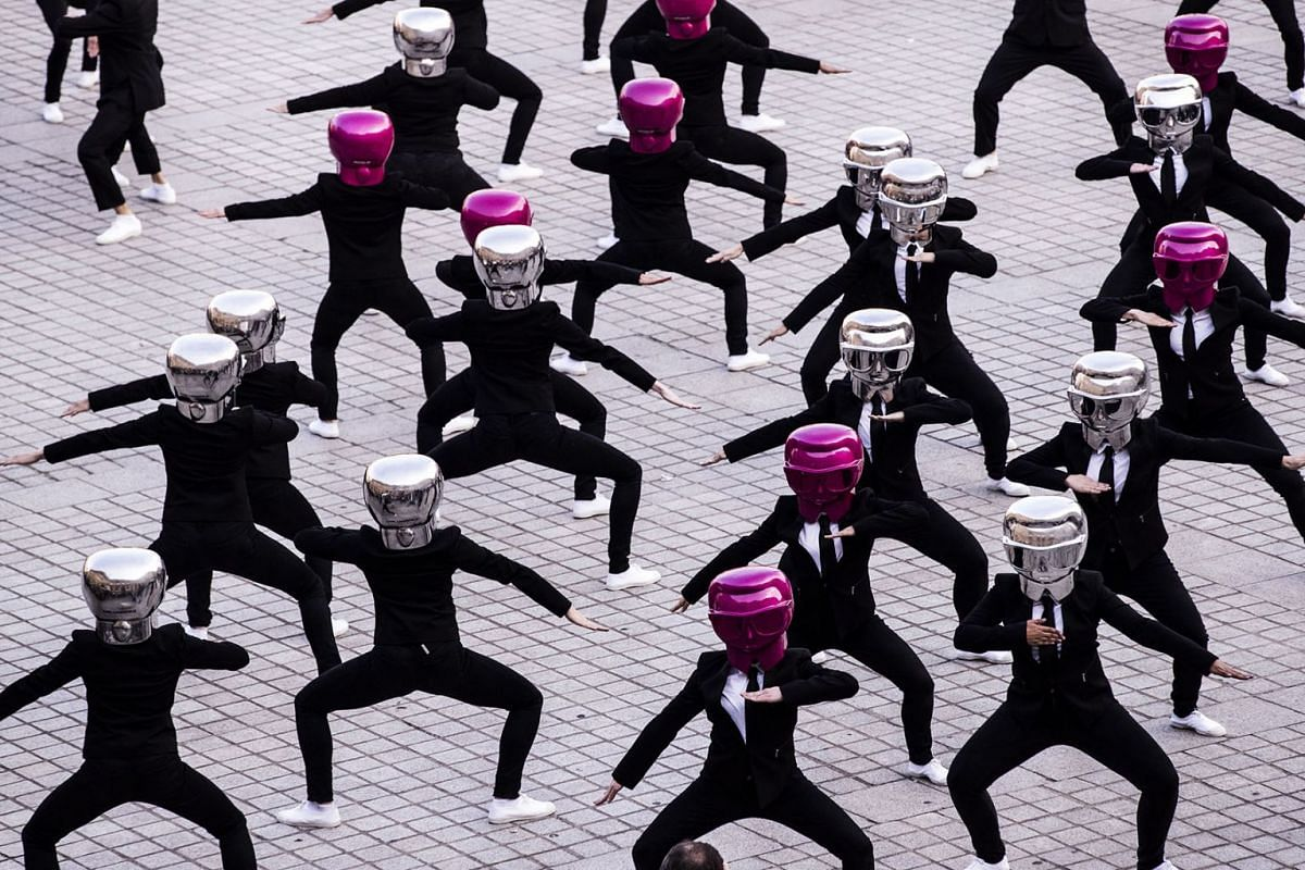 Performers dance wearing Karl Lagerfeld masks on Place Vendome to mark the launch of the Karl Lagerfeld + ModelCo makeup product line in Paris, France, May 15, 2018. PHOTO: EPA-EFE