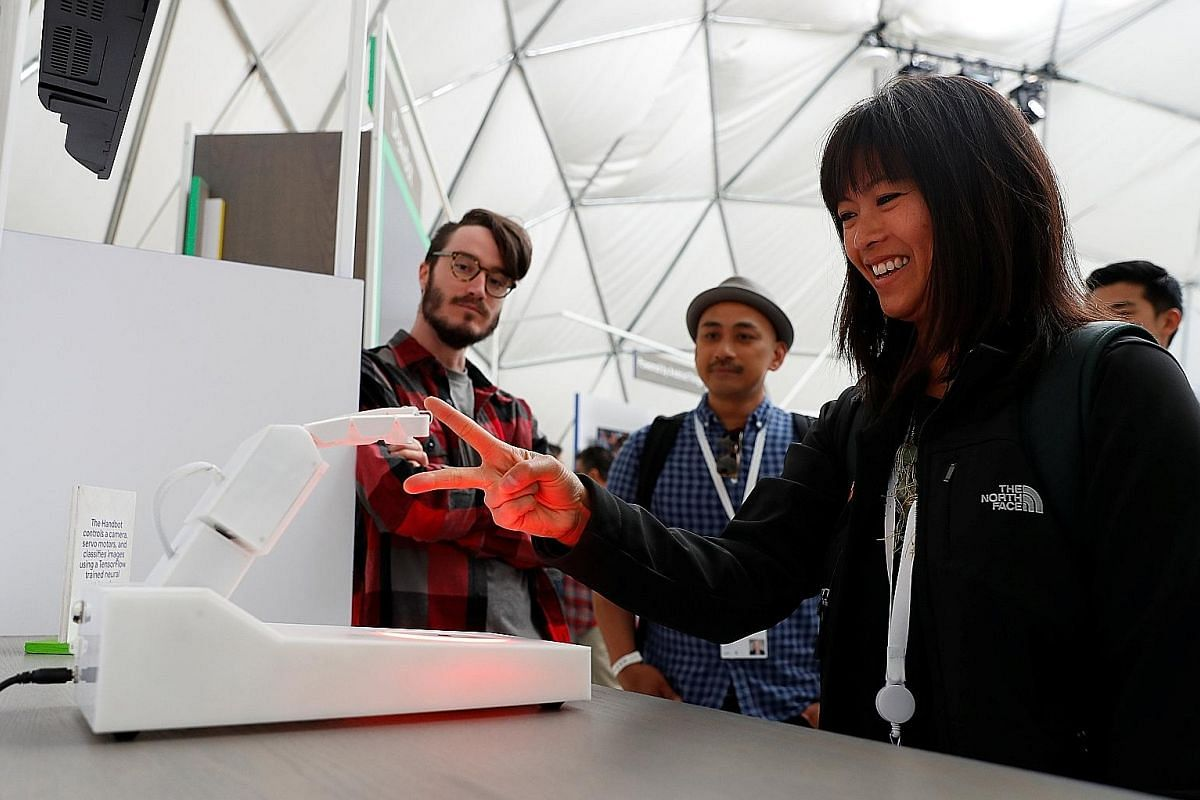 An attendee at the annual Google I/O in Mountain View, California, last week playing rock, paper, scissors with a Handbot robot.