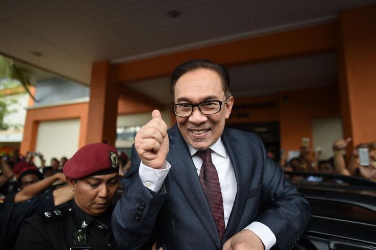 Anwar Ibrahim greeting his supporters after being released from the Cheras Hospital Rehabilitation in Kuala Lumpur on May 16, 2018.