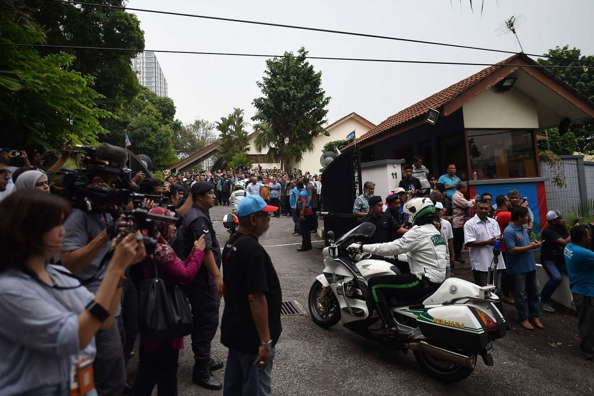 Journalists and supporters of jailed former opposition leader and current federal opposition leader Anwar Ibrahim arrive at his home after his release from the Cheras Hospital Rehabilitation in Kuala Lumpur on May 16, 2018.