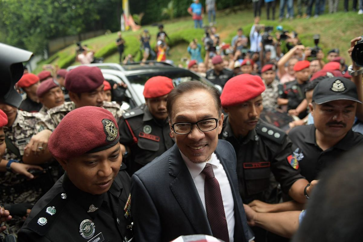 Mr Anwar Ibrahim making his way home after his release from Cheras Rehabilitation Hospital in Kuala Lumpur.