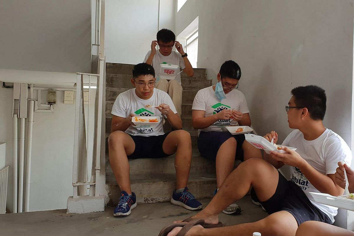 Volunteers from Hwa Chong Institution taking a lunch break.