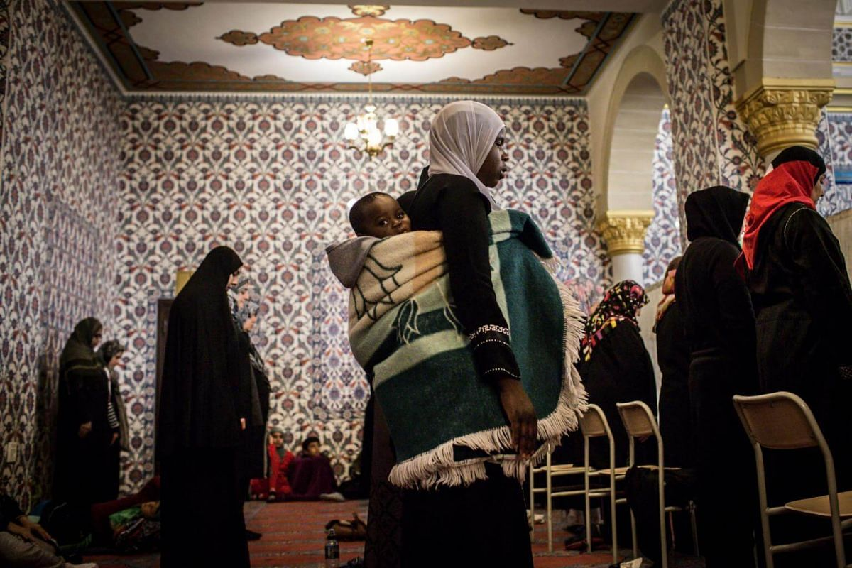 Muslim women pray the first Taraweeh evening prayer on the first day of the Muslim fasting month of Ramadan at the Nizamiye Mosque in Midrand, Johannesburg, on May 16, 2018.