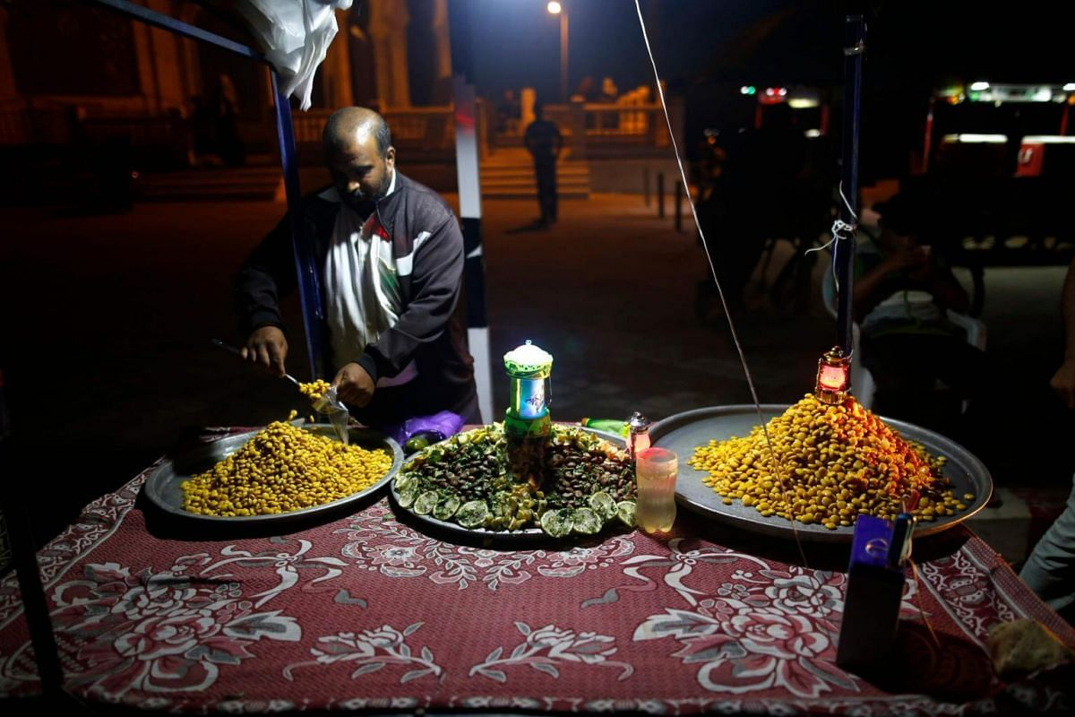 A Palestinian street vendor sells food in Gaza on May 16, 2018, as the faithful prepare to start the Muslim holy fasting month of Ramadan.