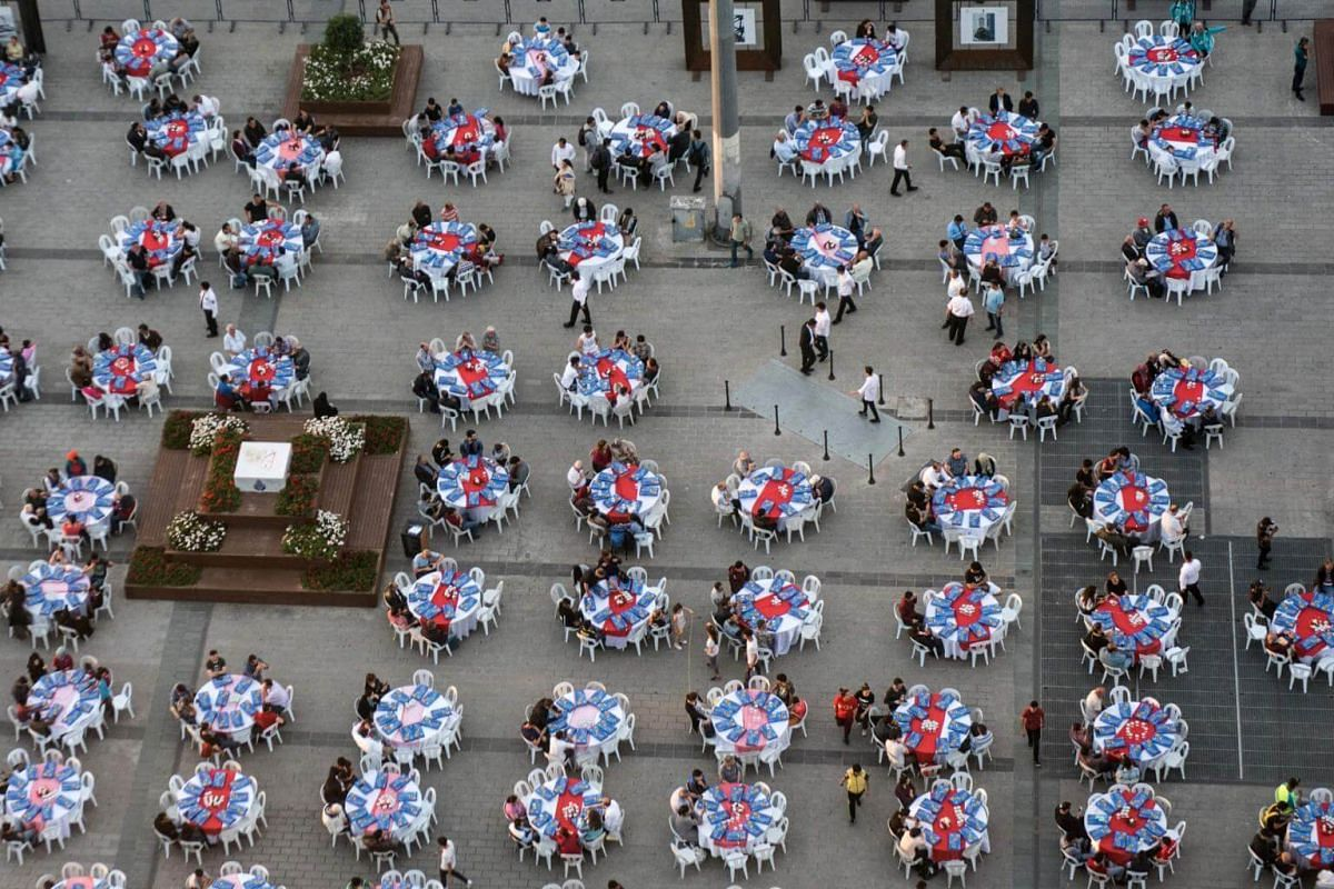 People breaking their fast on May 16, 2018, in Taksim Square in Istanbul, during the first day of the holy month of Ramadan.