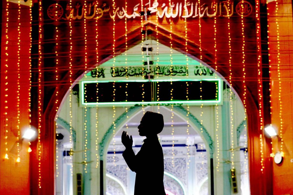A boy prays in a mosque during the holy fasting month of Ramadan in Karachi, Pakistan, on May 16, 2018.