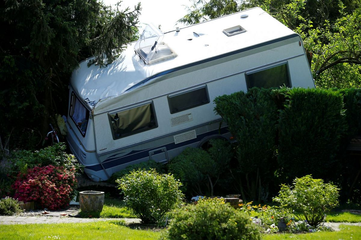 A caravan sits in a garden after a tornado last night hit the area of Boisheim, west of Duesseldorf, Germany, May 17, 2018. PHOTO: REUTERS