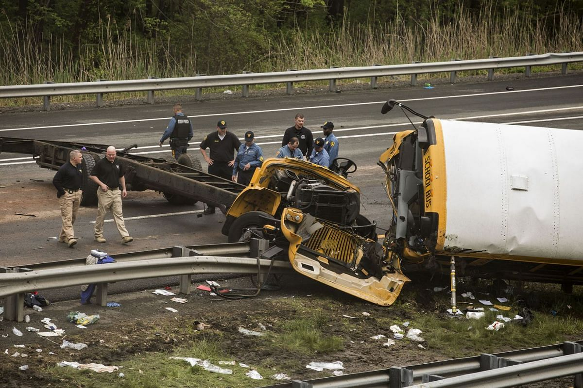 Investigators and first responders at the scene where a school bus collided with a dump truck on Route I-80 in Mount Olive Township, N.J., May 17, 2018. PHOTO: THE NEW YORK TIMES
