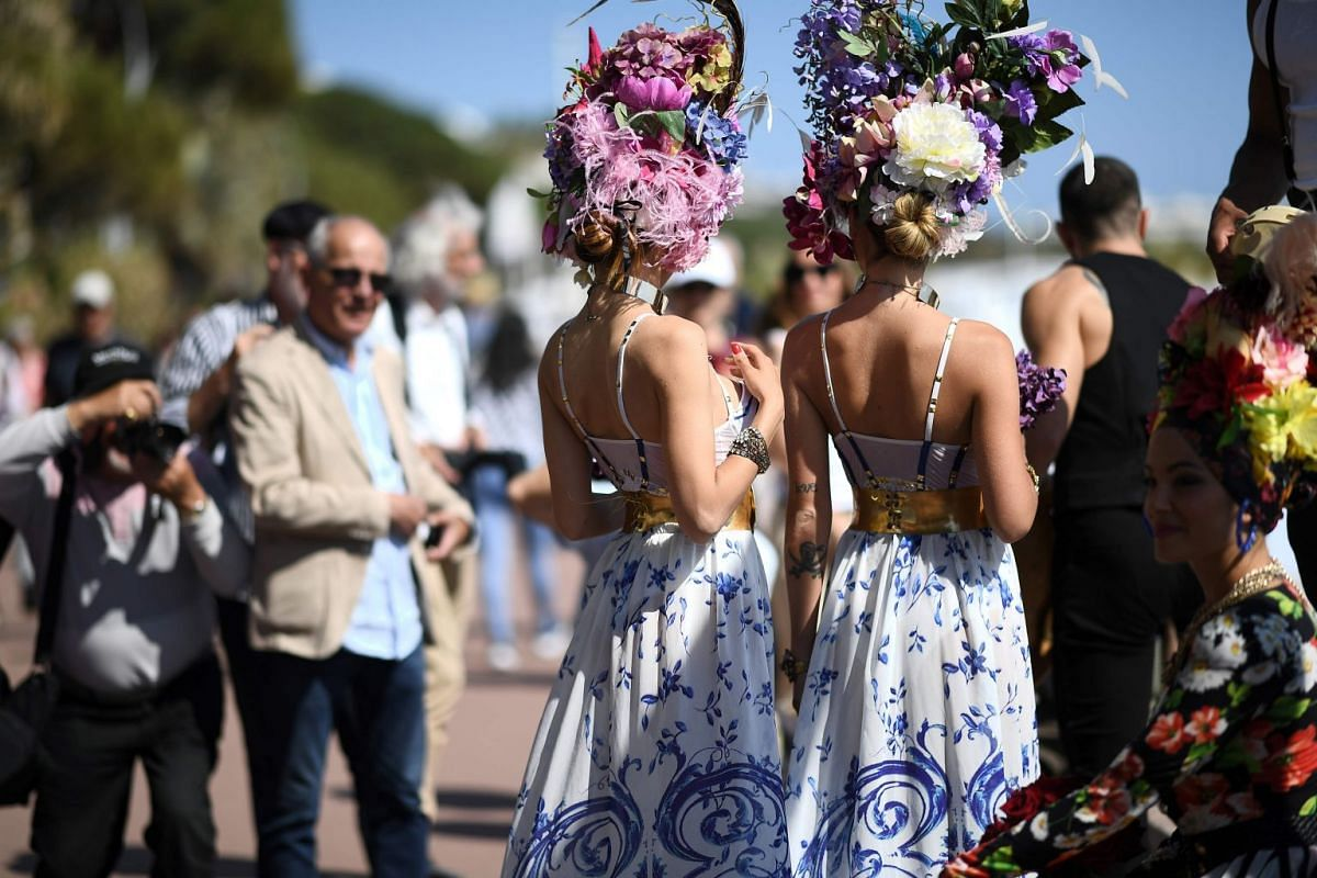 Festival goers parade on the Croisette on May 17, 2018 during the 71st edition of the Cannes Film Festival in Cannes, southern France. PHOTO: AFP