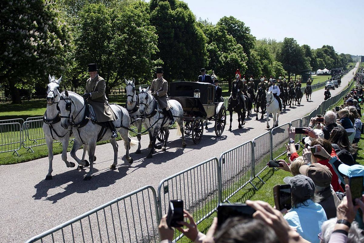 Military personal take part in a carriage rehearsal in Windsor, on May 17, 2018.