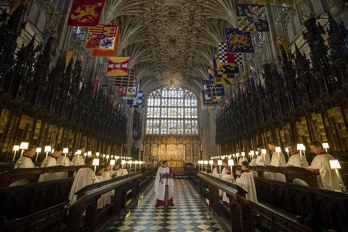 Director of Music at St George's Chapel in Windsor, James Vivian (centre) directs the St George's Chapel Choir during a rehearsal ahead of the wedding of Britain's Prince Harry and Meghan Markle, at St George's Chapel in Windsor, on May 14, 2018.