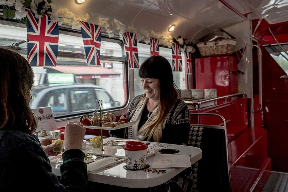 Passengers on board the Royal Tea Bus Tour in London, on May 16, 2018.