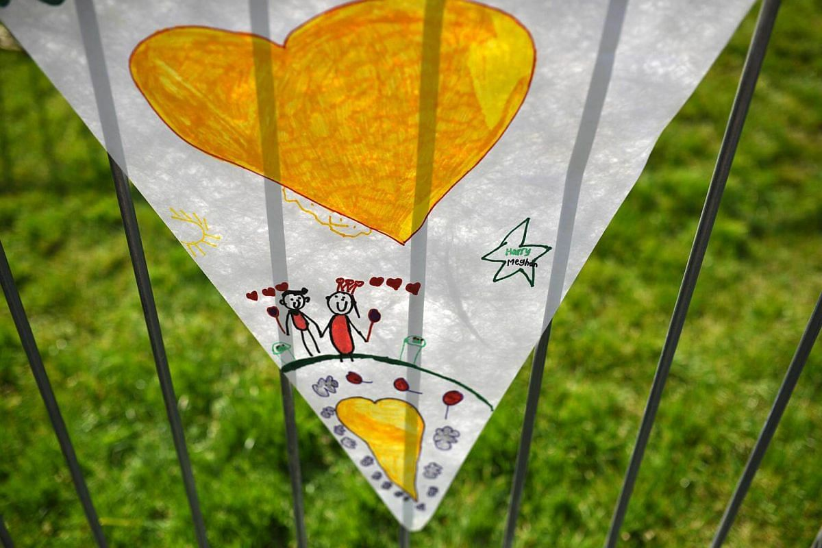 Bunting made by school children hangs on a barrier on The Long Walk, in Windsor, on May 17, 2018.