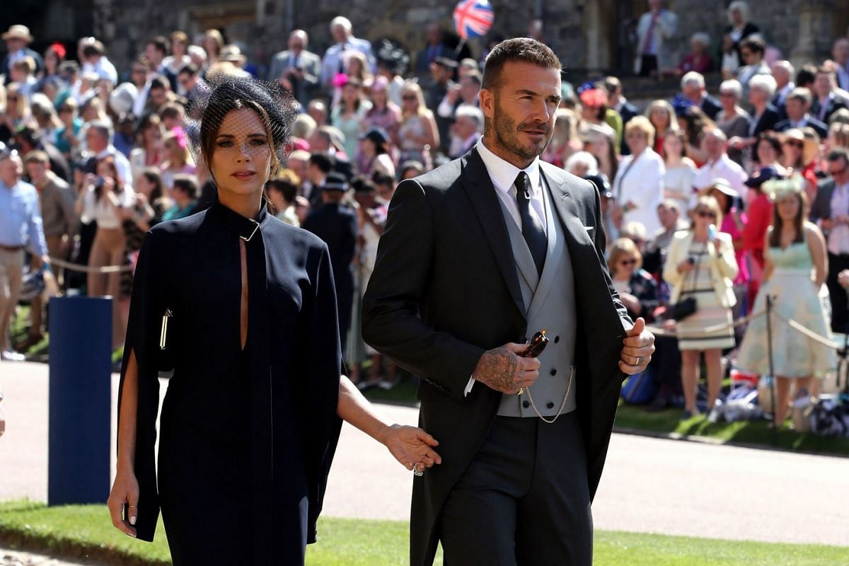 Former England footballer David Beckham his wife Victoria arrive for the wedding of Britain's Prince Harry and US actress Meghan Markle in Windsor on May 19, 2018.