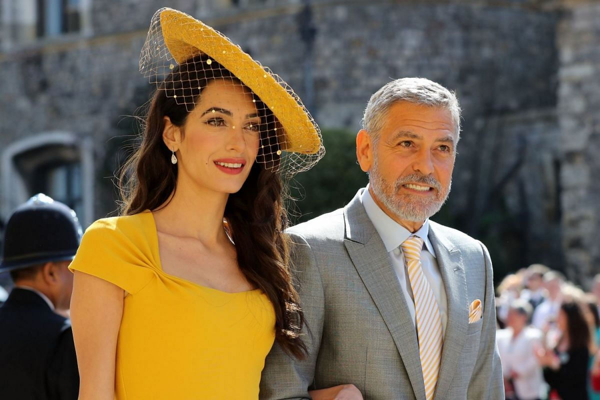 US actor George Clooney and his wife Amal arrive for the wedding of Britain's Prince Harry and US actress Meghan Markle in Windsor on May 19, 2018.