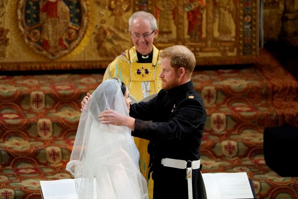 Britain's Prince Harry and US actress Meghan Markle during their wedding service in St George's Chapel at Windsor Castle on May 19, 2018.