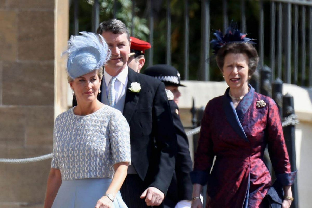 (From left) Britain's Sophie, Countess of Wessex, Vice Admiral Timothy Laurence and Britain's Princess Anne, Princess Royal, arrive for the wedding ceremony at St George's Chapel on May 19, 2018.