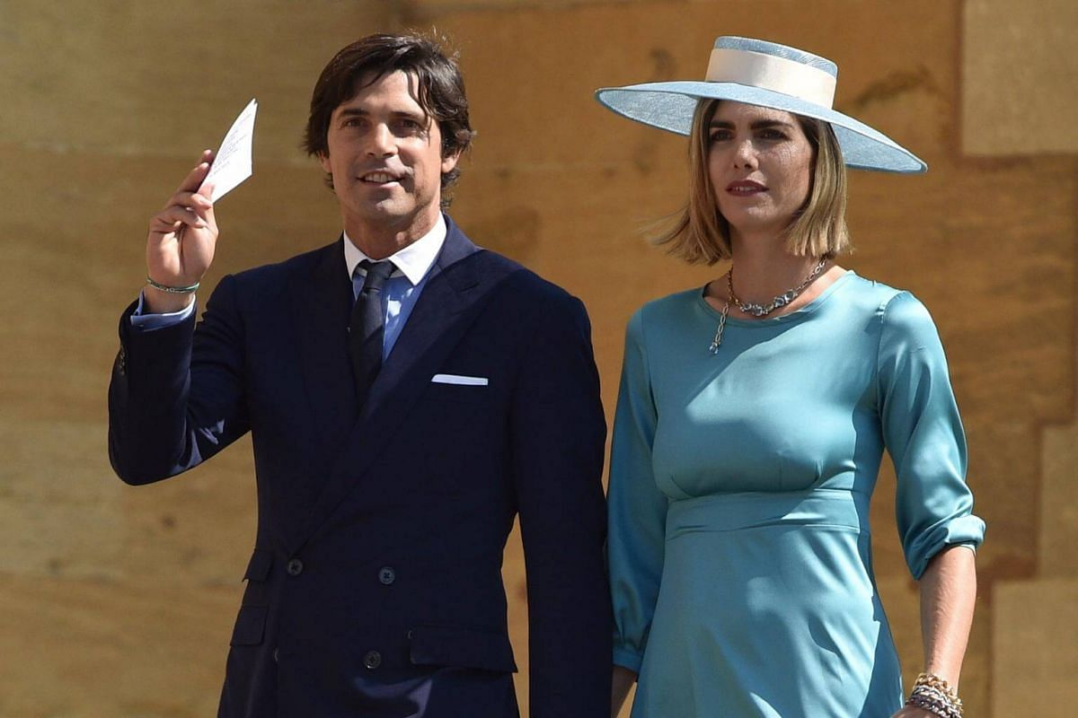 Prince Harry's friend, Argentinian polo player Nacho Figueras (left) and his wife Delfina Blaquier attend the royal wedding ceremony at St George's Chapel on May 19, 2018.