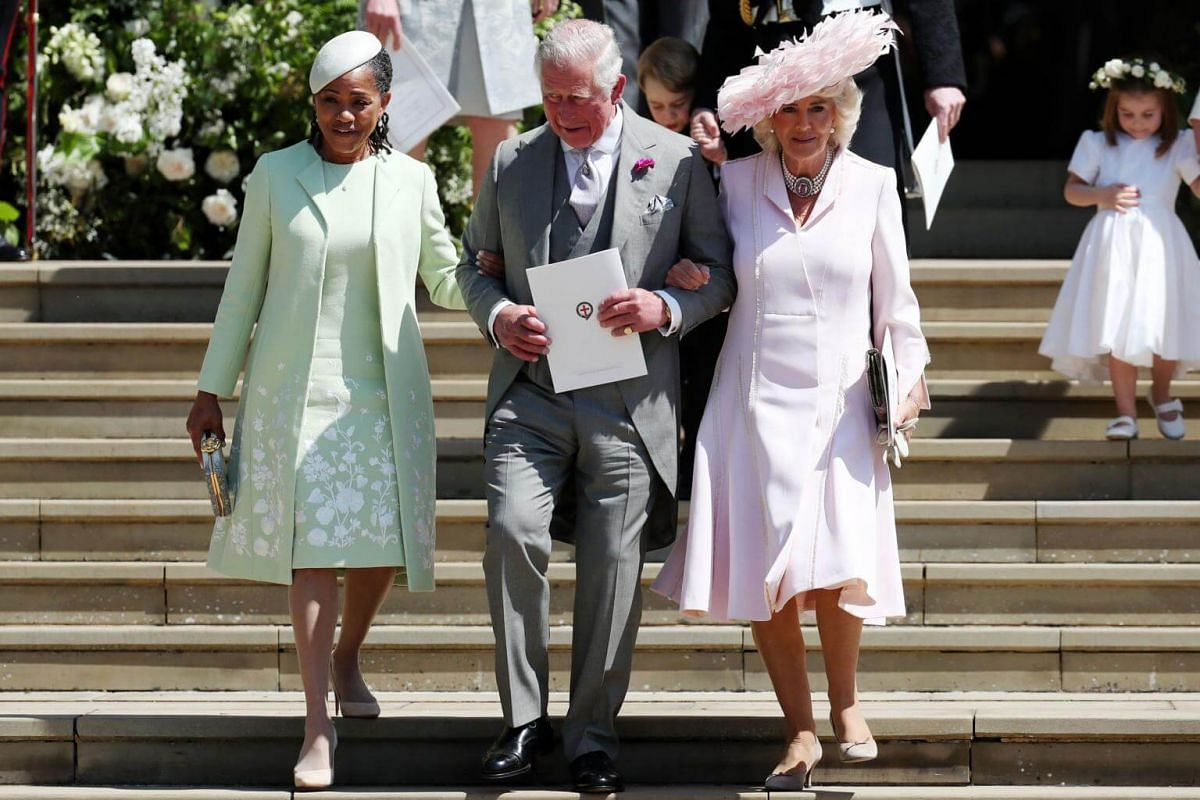 (From left) Meghan Markle's mother Doria Ragland, Britain's Prince Charles, Prince of Wales, and his wife Camilla, Duchess of Cornwall, leave after the wedding ceremony at St George's Chapel, on May 19, 2018.