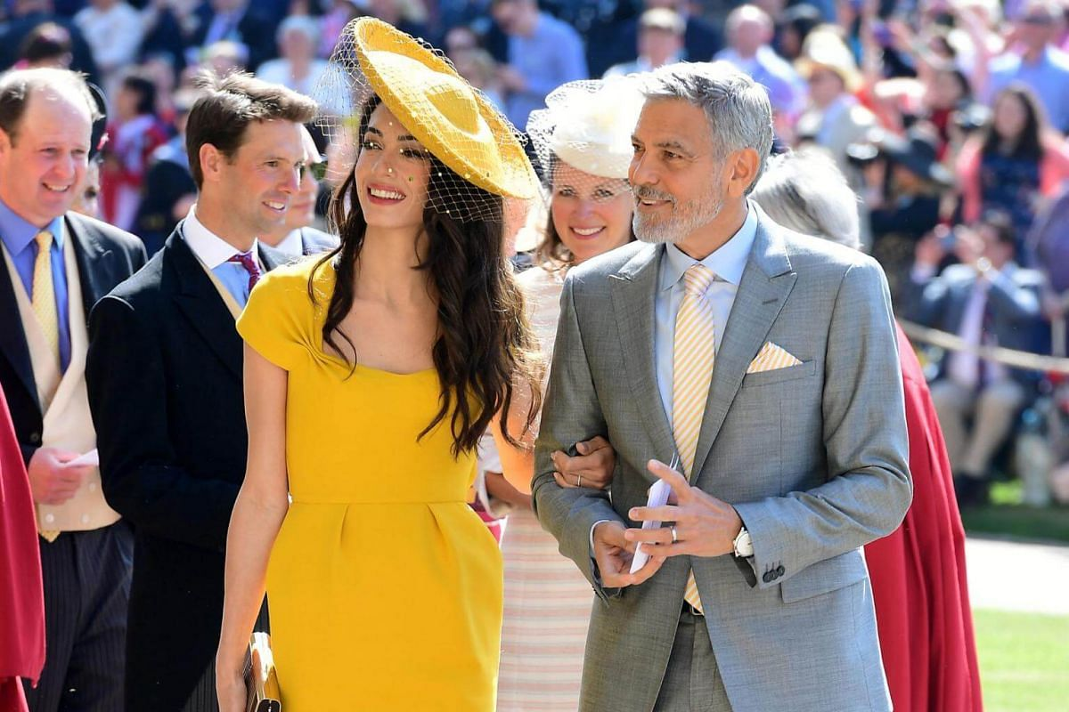 Amal and George Clooney arrive at St George's Chapel for the wedding on May 19, 2018.